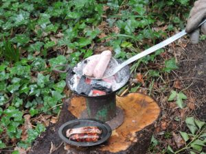Ladle-charcoal-pot-cooking-sausages